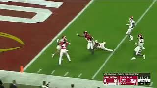 Josh Jacobs trucks an Oklahoma defender for a touchdown