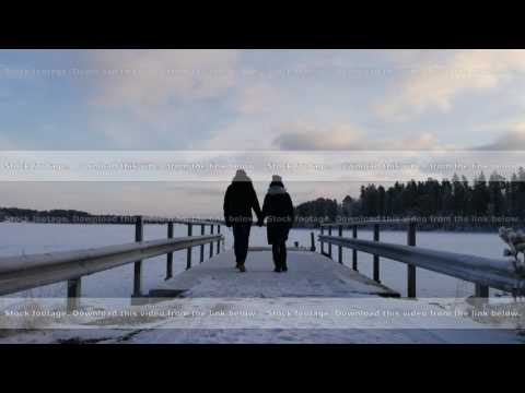 young couple walking together during winter holidays in scandinavia