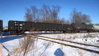 CN SD75I, SD70M-2 move tank cars and Union Pacific hoppers past Schoolcraft station.