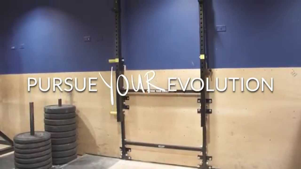 Again Faster Wall-Mounted Folding Power Rack - YouTube