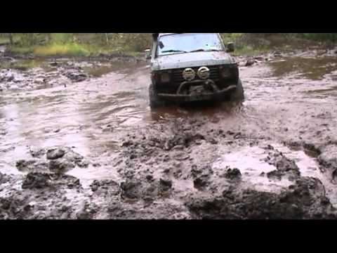 Toyota HJ60 playing in the mud.