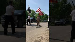 Keeping the tradition alive - Local Vets carry the American Flag down State Street on Memorial Day