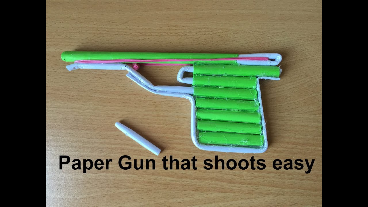 How To Make A Paper Gun That Shoots Easy Youtube