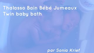 Newborn twins seen on video hugging each other during bath  Read more: Newborn twins seen on video h