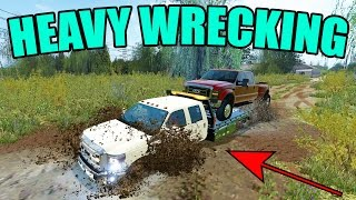 FARMING SIMULATOR 2017 | PULLING TRUCKS OUT OF MUD | HEAVY WRECKER