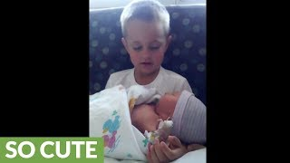 Little boy meets newborn baby brother