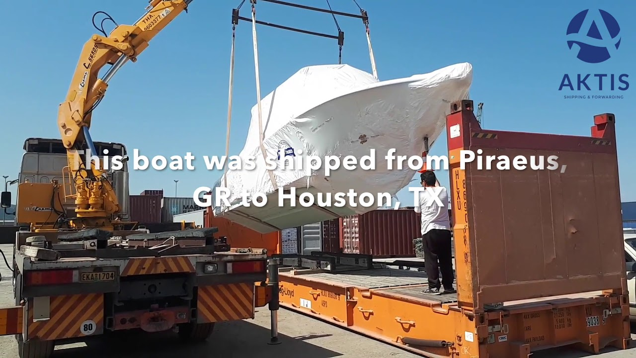 Loading of boat on 40' flat rack container