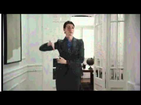 Business Woman in Gray Suit and Blue Blouse Dancing