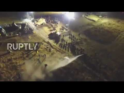 Drone dodges water cannon to capture Dakota pipeline protest
