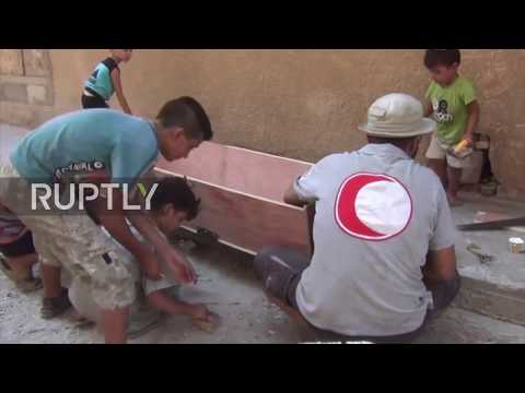 Syria: Volunteers make coffins as deaths soar in besieged Deir ez-Zor *EXCLUSIVE*