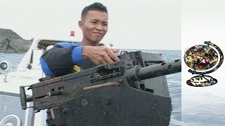 Aceh Separatists Suppressed By Indonesian Military (2002)