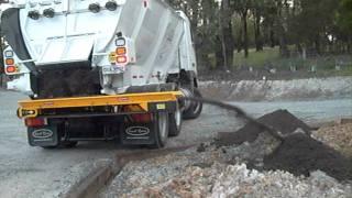 Trout River side conveyor unloading topsoil - Trout River Australia