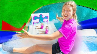 Sliding Through Impossible Shapes on Worlds Biggest Inflatable WaterSlide !!! - $10,000 Challenge