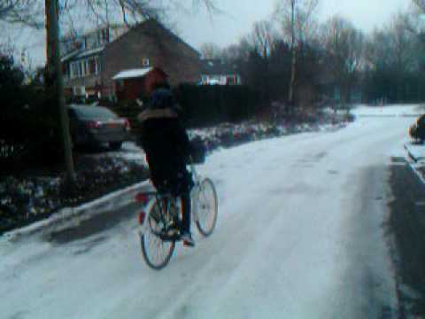 A trip home from school in cold weather. Assen, Netherlands