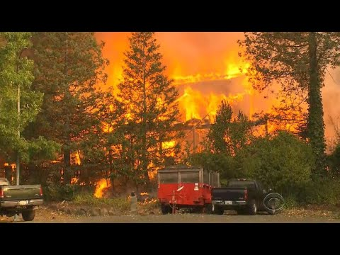 Fast-moving California wildfires threatening thousands of homes