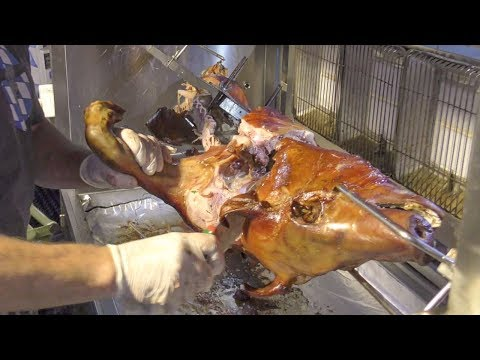 Whole Pork Roasted And Cut. Germany Street Food. Italy Fair