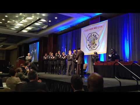Andrew Holmes recieves the Richard J. Daley Police Medal of Honor Award