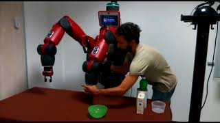 Vibrotactile Feedback for Aiding Robot Kinesthetic Teaching of Manipulation Tasks