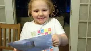 Millie,  gets a Blue Peter badge - she is so happy