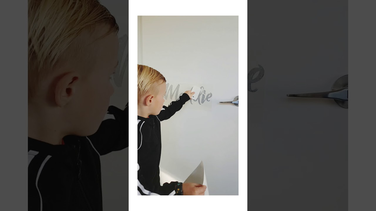 Applying 'Cheeky Raskal' Wall Decals
