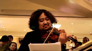 Mr. Taro Hakase, who is a famous Japanese violinist, had a charity ...