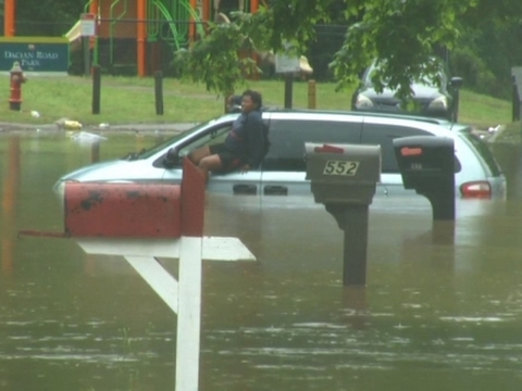 Raw: Woman Escapes Flooded Minivan in Raleigh