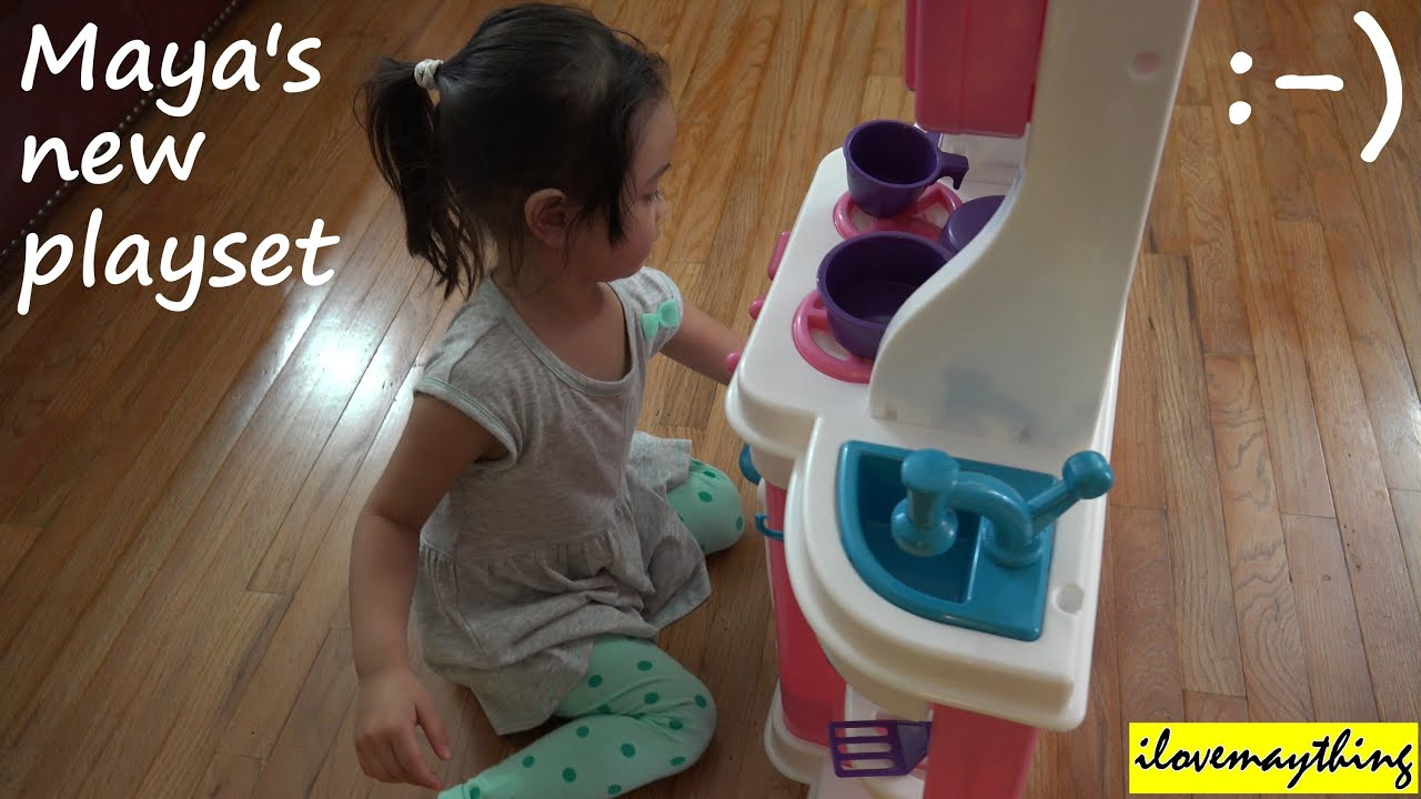 Toys for kids a little girl playing her new kitchen toy for Little girl kitchen playset
