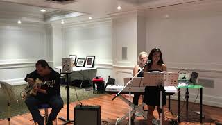 The Girl from Ipanema Sung by Sinta's student , Michael Fearson on guitar and Sinta on keys