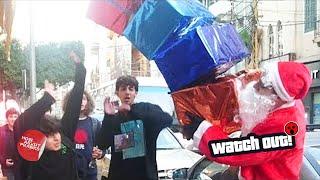 Santa 'Drops' Presents on People Prank