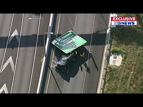 Josh Healy - Enormous Freeway Sign Falls on a Car