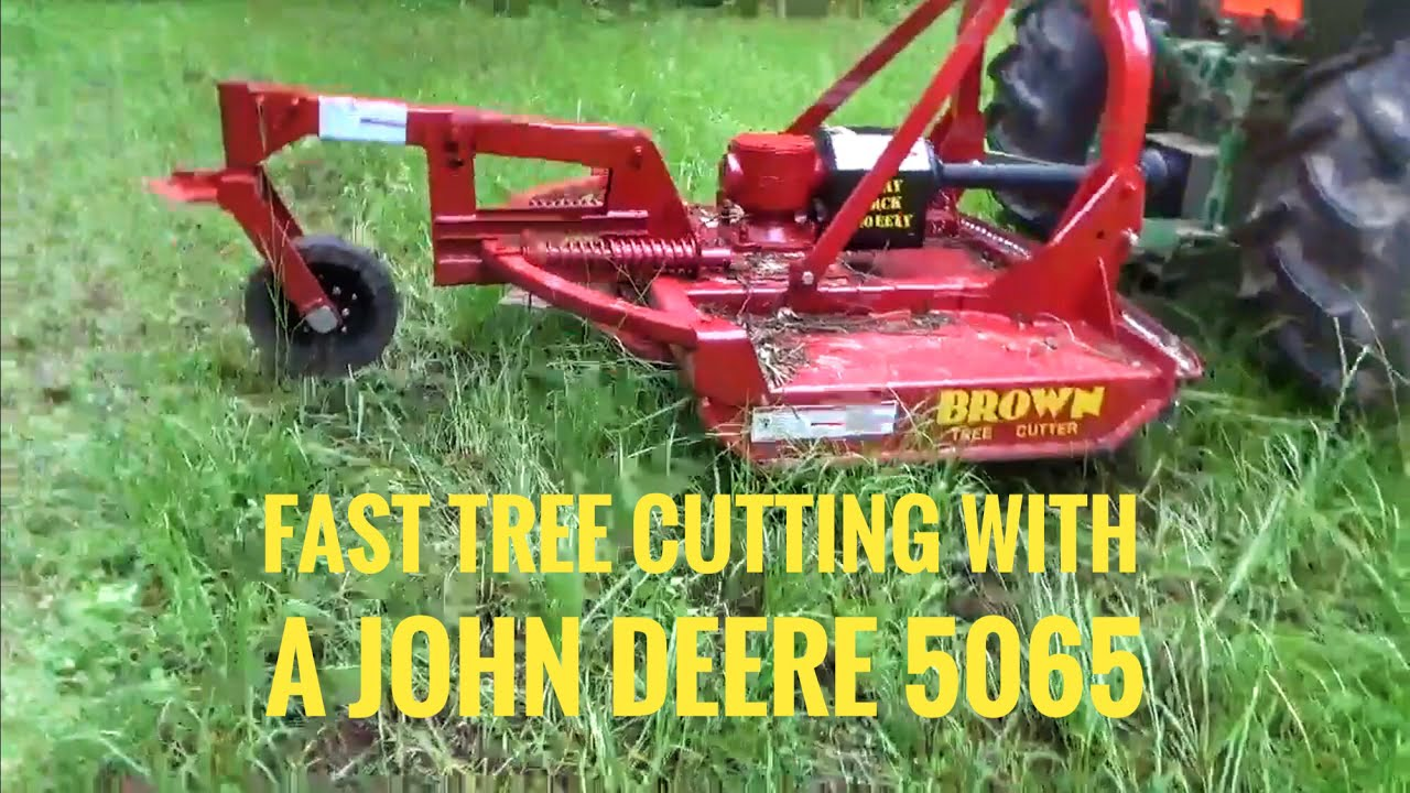 Tree Cutter New Brown Tree Cutter In Action On A John Deere Tractor
