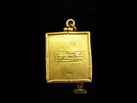 Antique 14k wind up music box pendant
