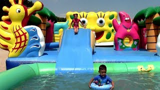 Funny kids Jumping into the Pool and Swimming