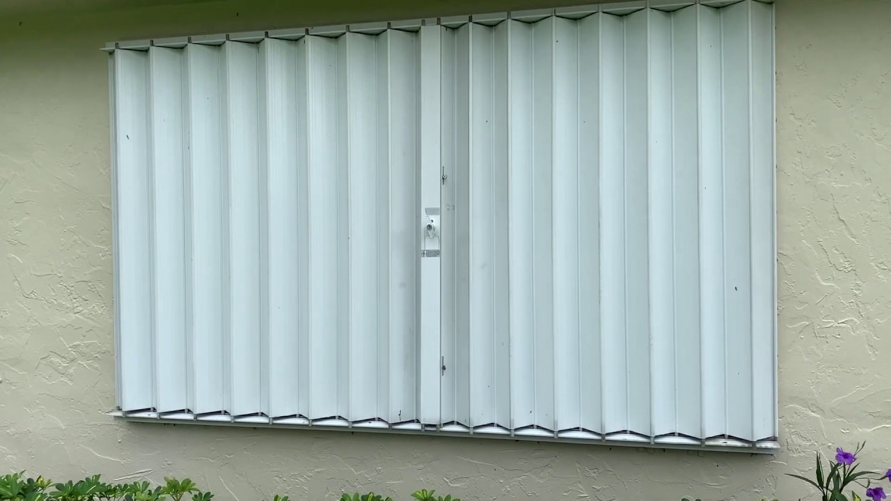 How To Open And Close Roll Up Crank Hurricane Shutters Youtube