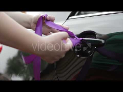 Purple Ribbon on the Handle of the Car