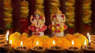 Diwali celebrations with traditional marigold flowers, Diya (light) and idol of the Hindu God, Ganesha and Lakshmi