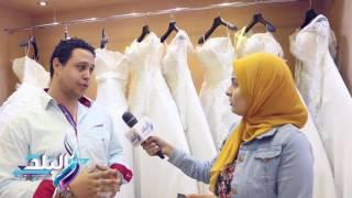 صدى البلد | فساتين الزفاف تصل 12 ألف جنيه .. والعروسة تلبس والعريس يلبس