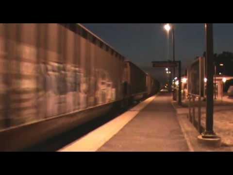 Metra Train 2522 and CP coke train at Franklin Park.wmv