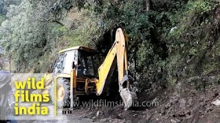 Construction vehicle JCB backhoe digging soil, India