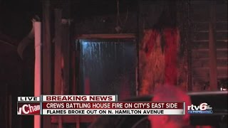Crews battling house fire on city