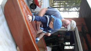 Jax Ryder Piloting Grandpas' Mahogany Speedboat Baby Cradle. Speed Boat, Speedster