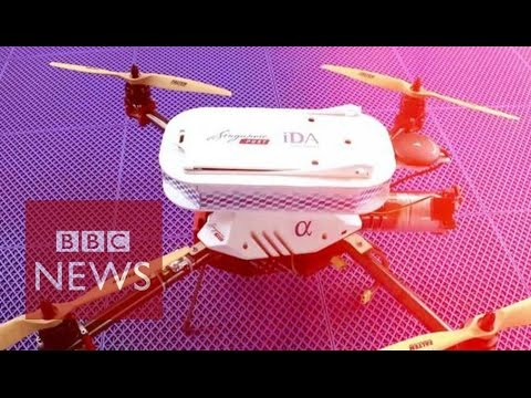 Drone flies over sea to deliver Singapore Post package - BBC
