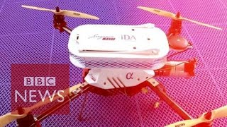 Drone flies over sea to deliver Singapore Post package - BBC News