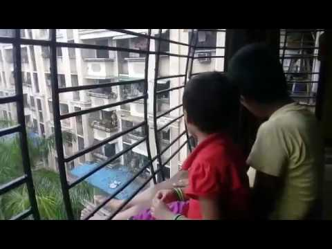 Kids welcoming monsoon rain