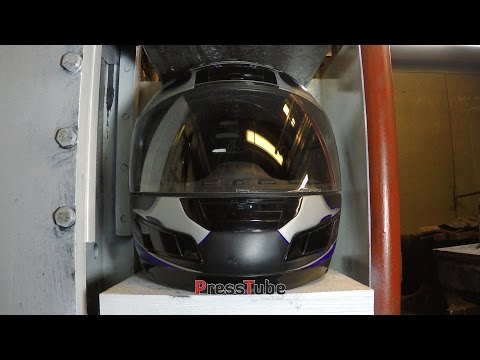 Crushing Motorcycle helmet with hydraulic press