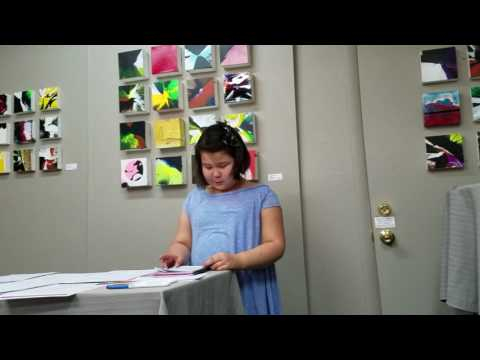 lilly jay hetrick-ludy reading her breakfast poem at children's poetry day.