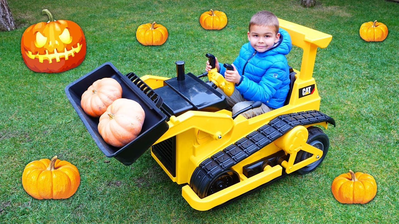 Dima harvest pumpkins for Halloween on power wheels bulldozer