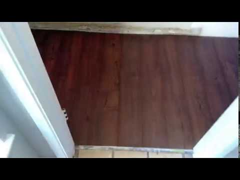 Installing laminate flooring in the bathroom and kitchen youtube for Installing laminate flooring in bathroom