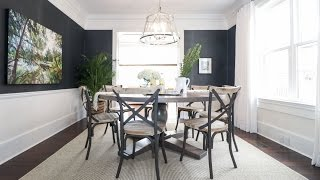 This dark-walled dining room is full of organic textures