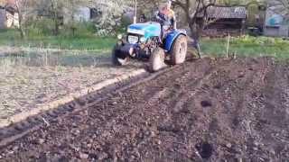 Оборотный плуг на минитрактор  вспашка почвы